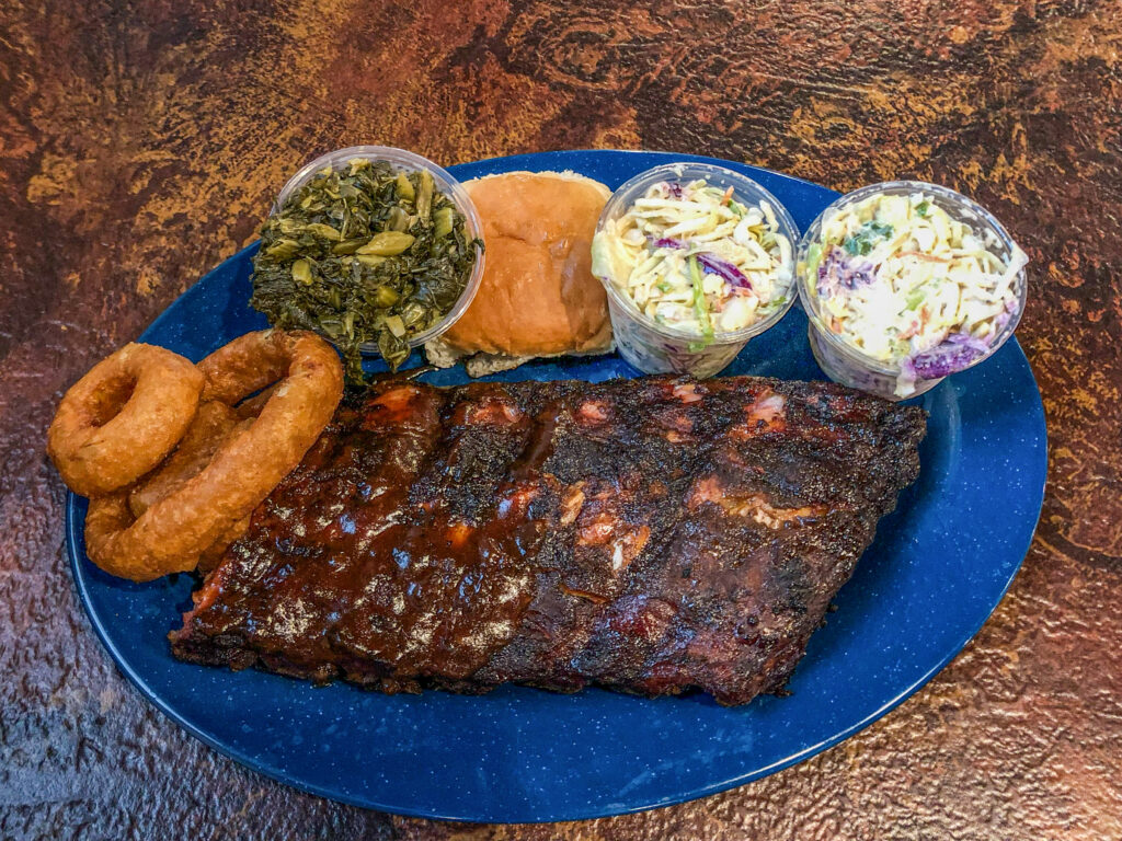 Slab of meat and sides at bbq restaurant in Memphis, Tennessee.