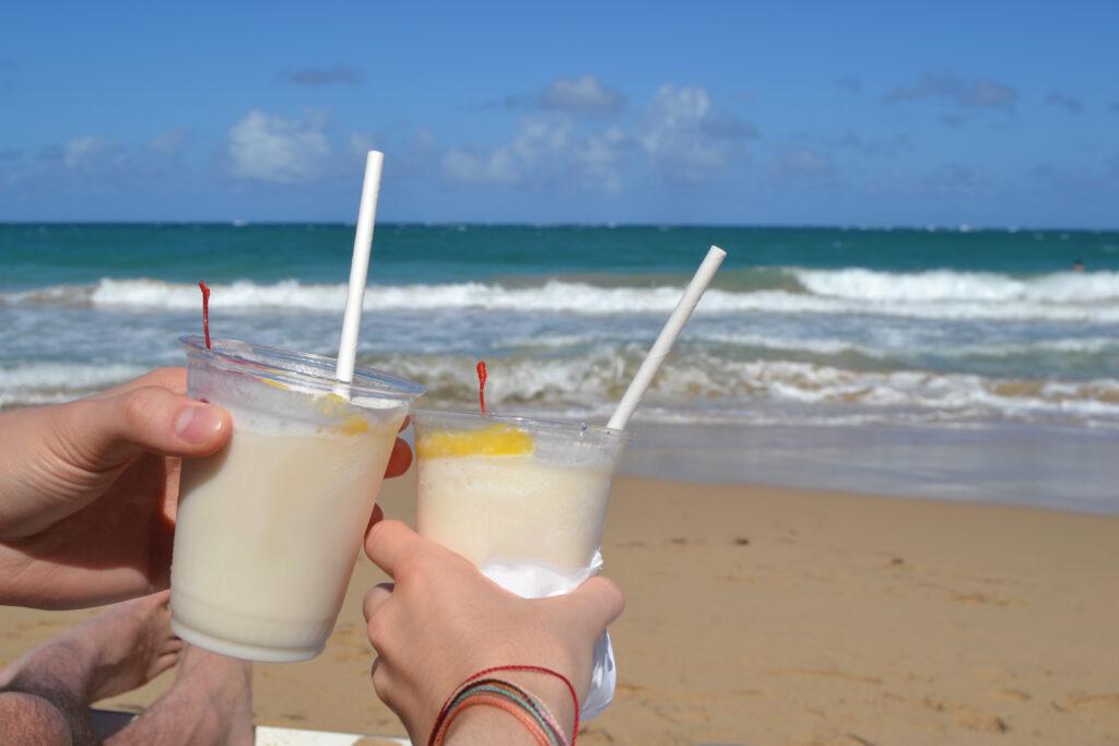 Enjoying piña coladas on the beach.