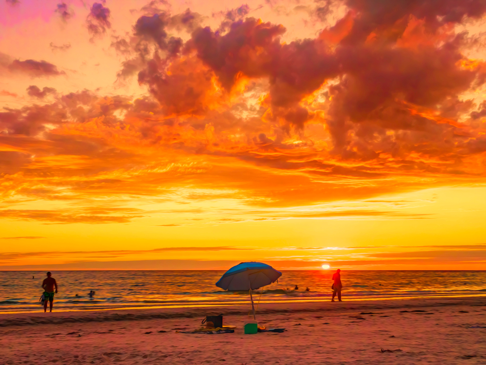 Beach scene on a barrier island along the Gulf Coast at sunset near the start of summer, west central Florida, USA, with digital painting effect, for themes of social distancing, recreation, weather