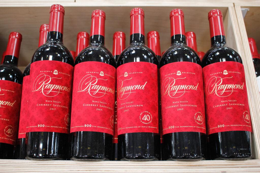 Several bottles of Raymond Cabernet Sauvignon wine.