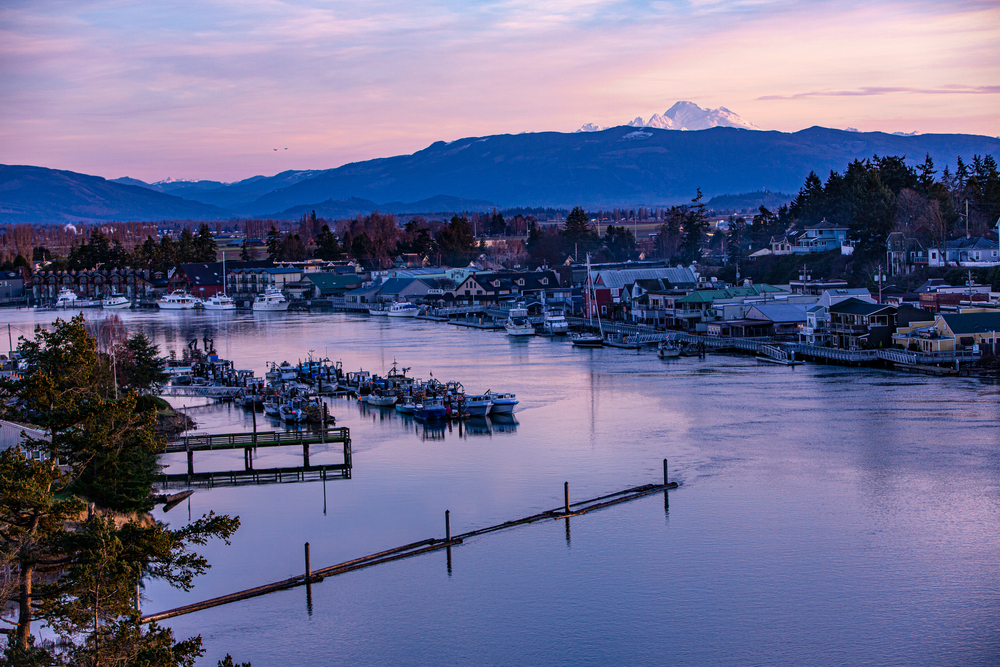 USA, Washington State, La Conner. Swinomish Channel with Mt. Baker in the background.