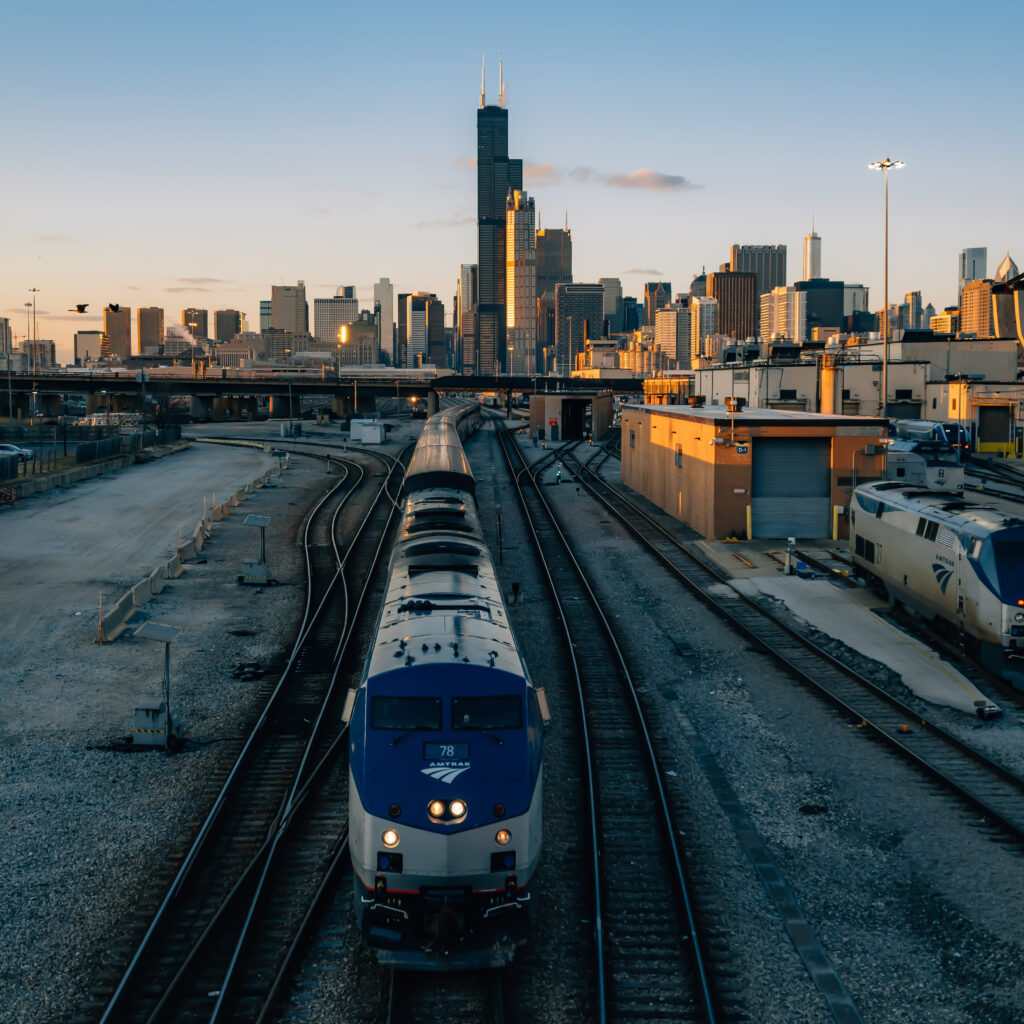 Chicago skyline and in the foreground an Amtrak train.
