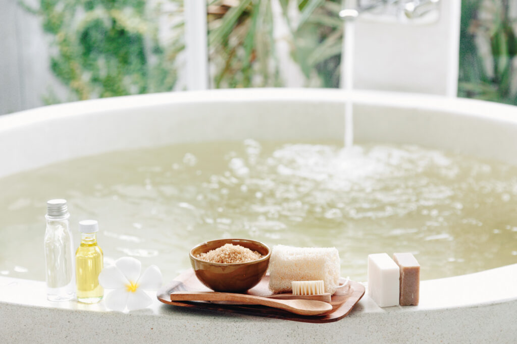 The perfect bath with natural organic products on a bathtub.