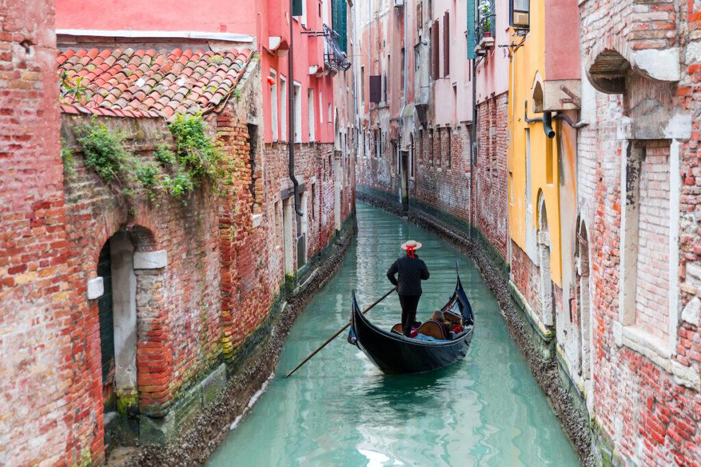Gondola in a canal in Venice.