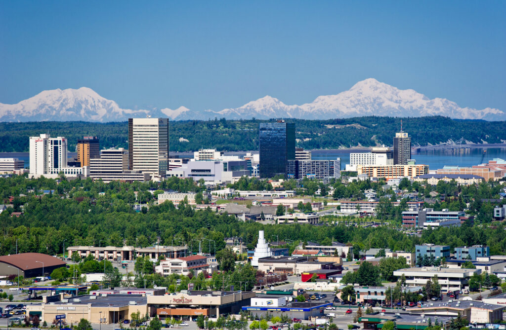 Alaksa, Anchorage. Aerial view of the city taken from a helicopter during the summer. Body of water behind is Cook Inlet.