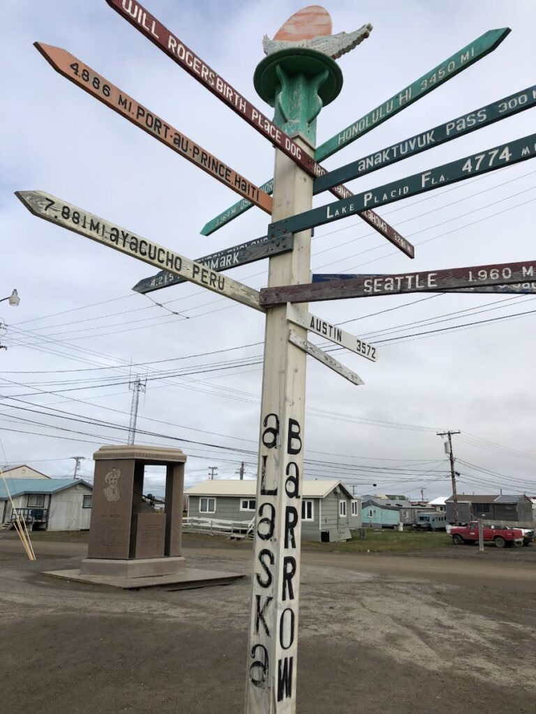 A multi-directional sign pointing to almost everyone in Utqiagvik, Alaska.