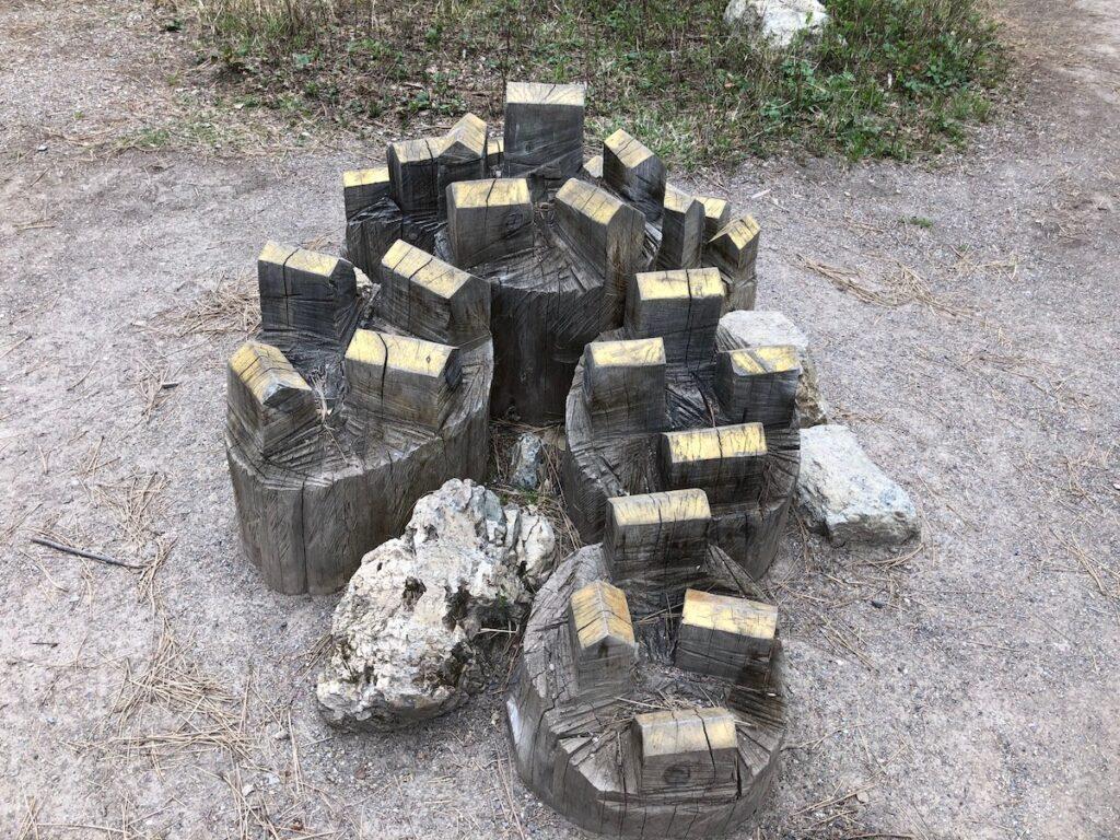 Cabin sculptures at Blackfoot Pathways: Sculpture in the Wild.