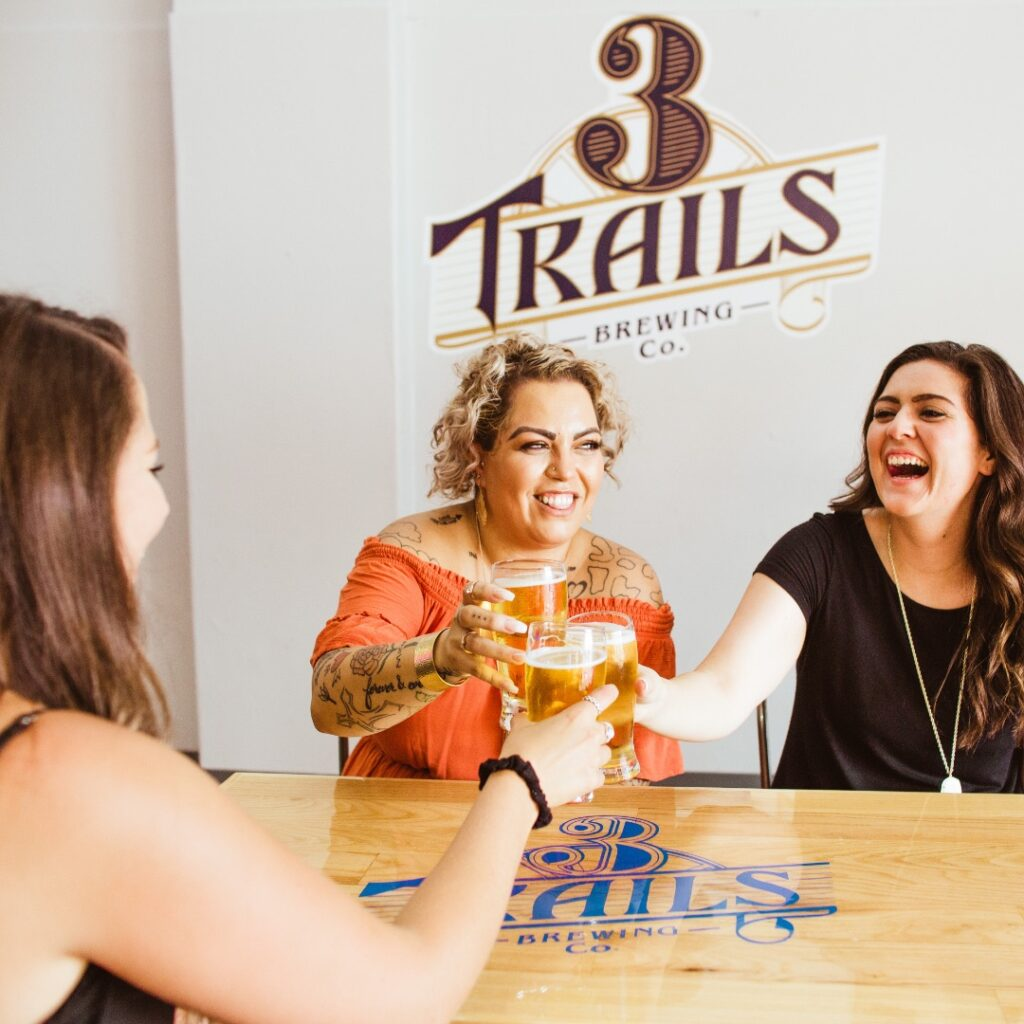 women drinking craft beer at 3 Trails Brewery in Independence, MO