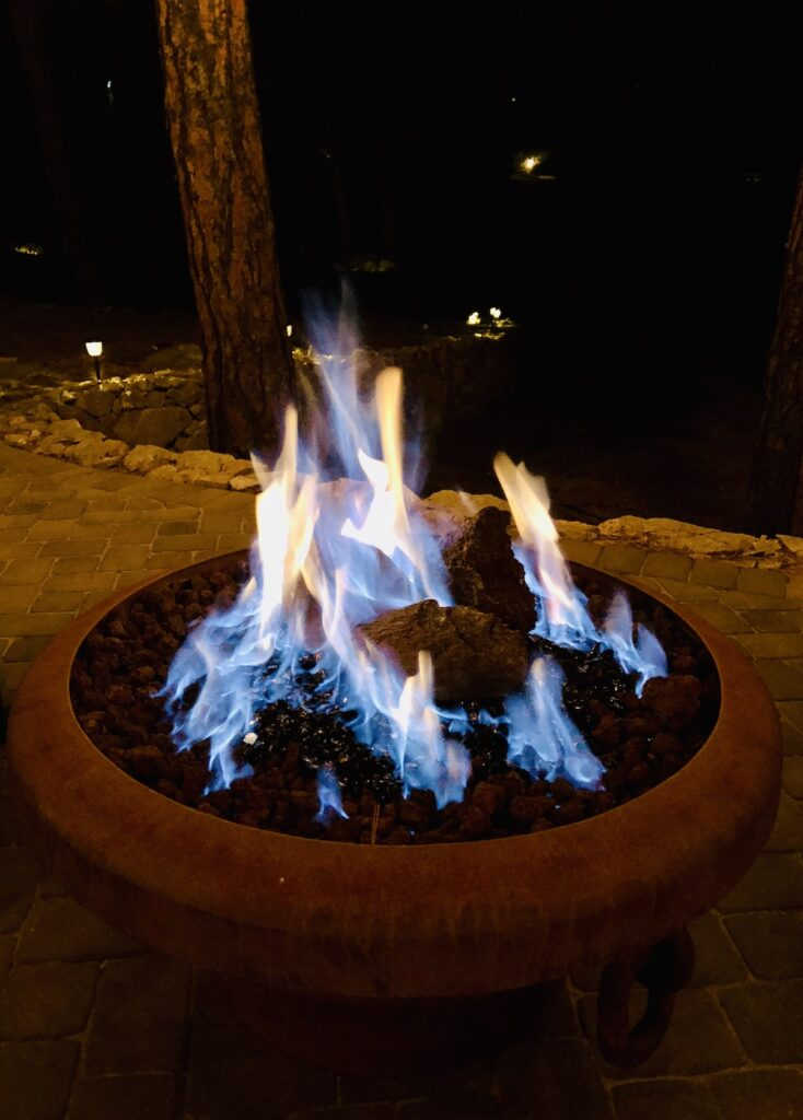Fire pit, lit at night.