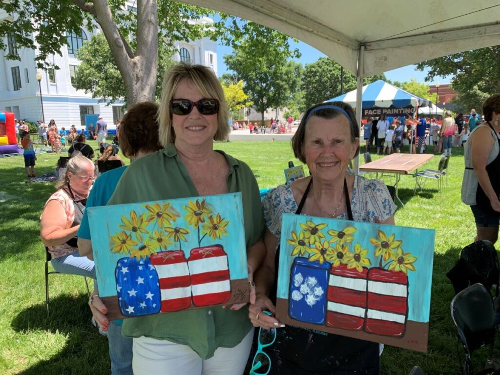 The author and her mother showing off the paintings they created.