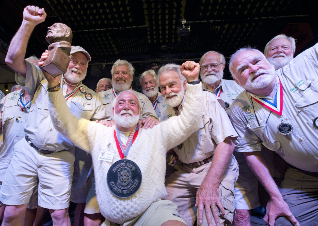 Look alike winners from previous years at the Hemingway Days Party in Key West.