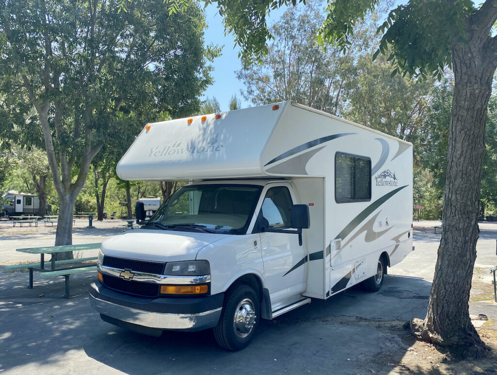 RV from RVShare parked at a campground in California.