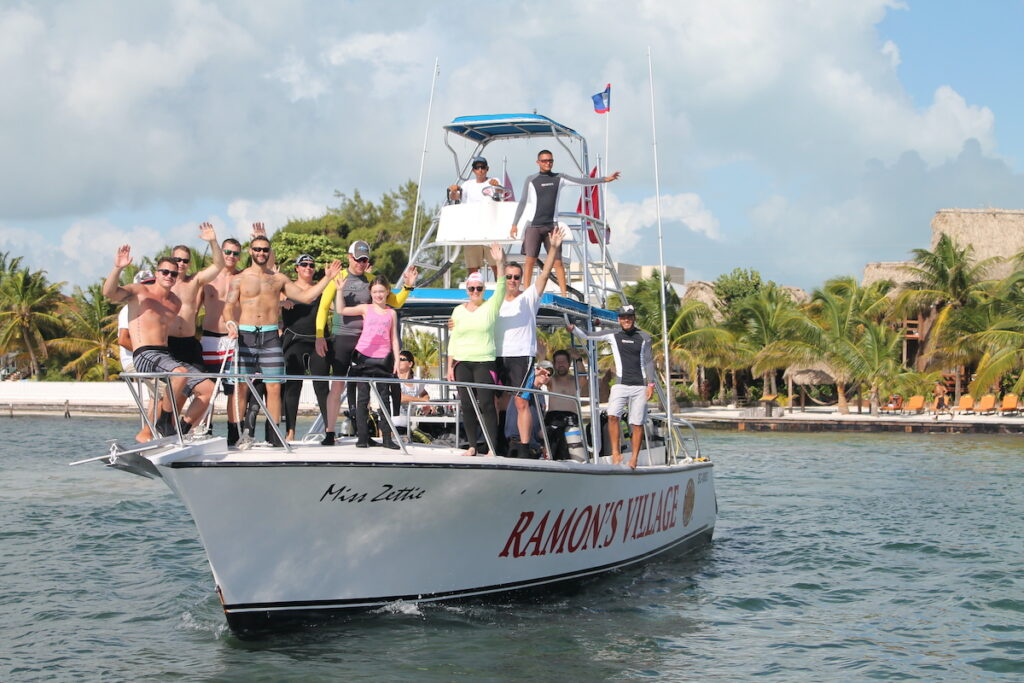 Ramon's village scuba boat out on the water with scuba divers.