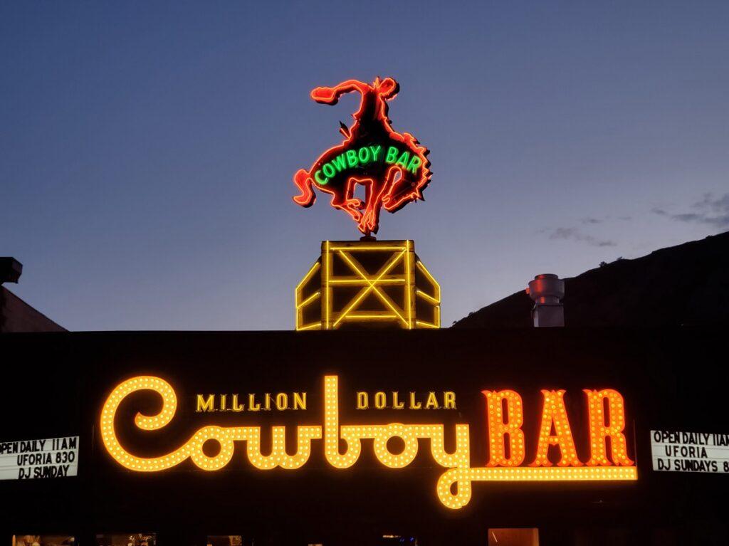 The Million Dollar Cowboy Bar vintage sign