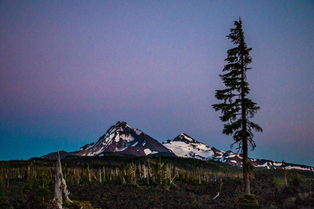 The McKenzie-Santiam Scenic Byway offers views of the Sisters Mountains.