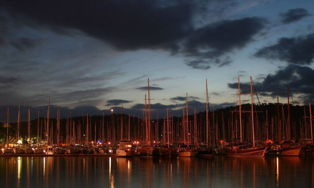 sailboats docked at dusk