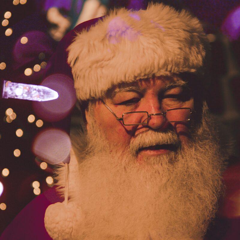 bokeh photography of Santa Claus