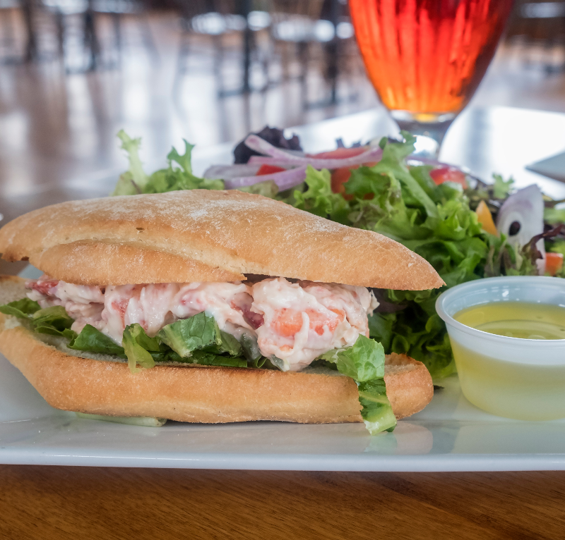 Lobster Roll Served with Fresh Green Salad and Glass of Beer