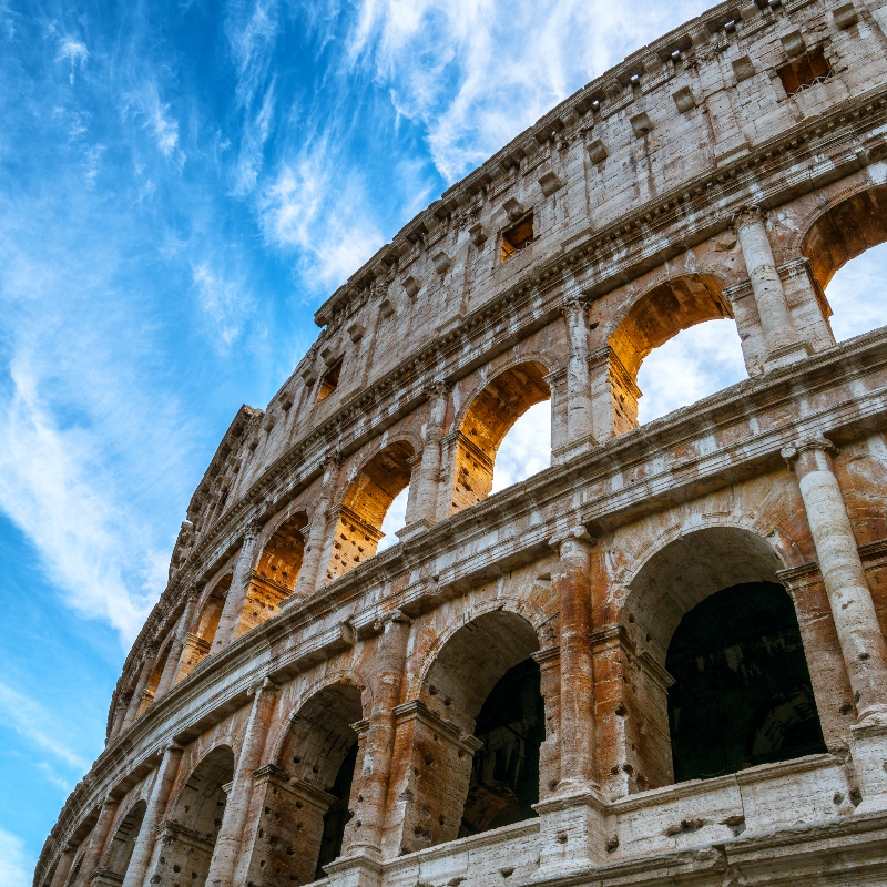 Close up view of Rome Colosseum in Rome , Italy . The Colosseum was built in the time of Ancient Rome in the city center. It is one of Rome most popular tourist attractions in Italy .