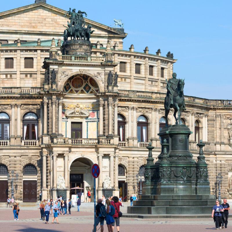 Tourists near Semperoper in Dresden, Germany.