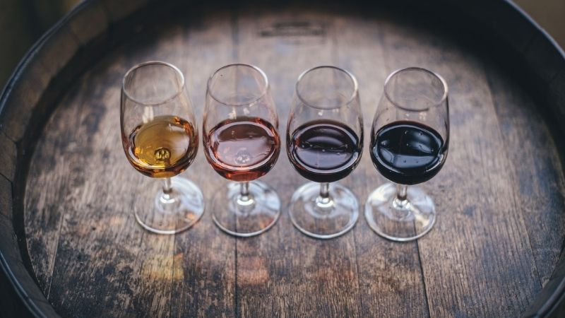 four glasses of wine on barrel from Shaw Academy wine appreciation course