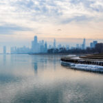 Chicago skyline with Lake Michigan in the foreground.