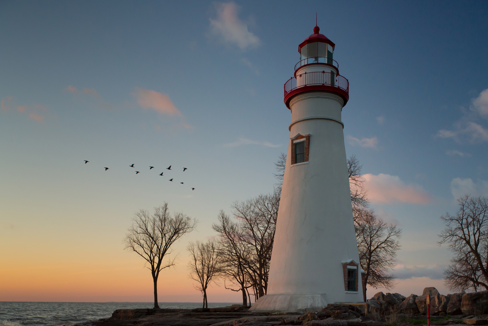Marblehead Lighthouse in Ohio with cormorants in the background.