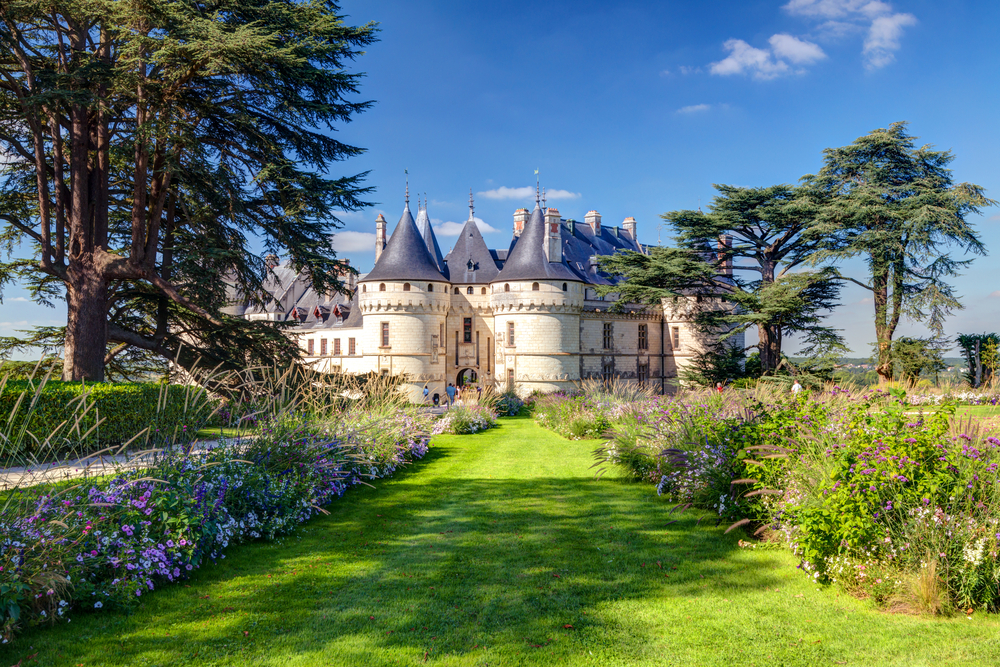 Panorama of Chateau de Chaumont-sur-Loire in summer, Loire Valley, France. It is a famous historical landmark of Loire Valley. Scenic view of the old fairytale castle with a beautiful flower garden.