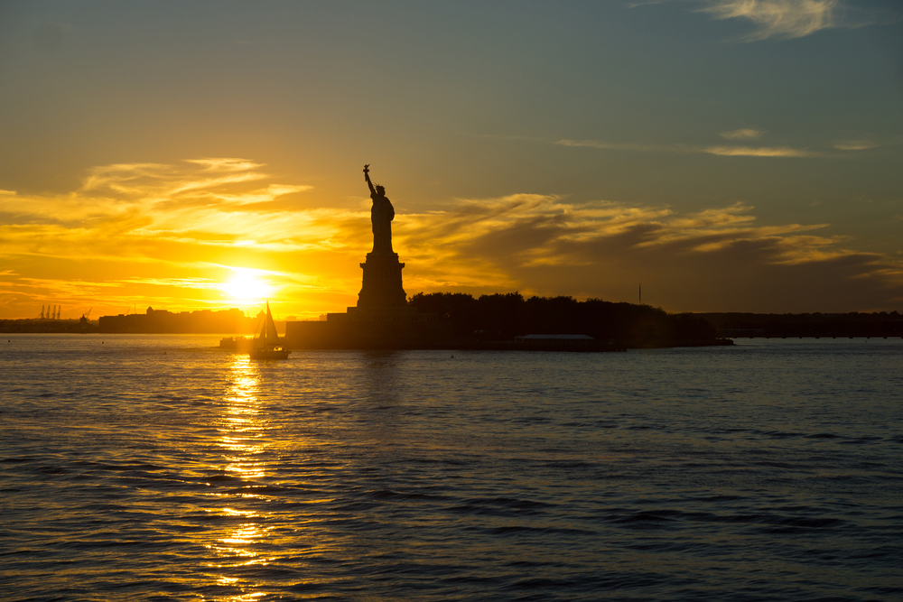 Statue of Liberty on a misty sunset as seen from the Staten Island Ferry, New York, United States