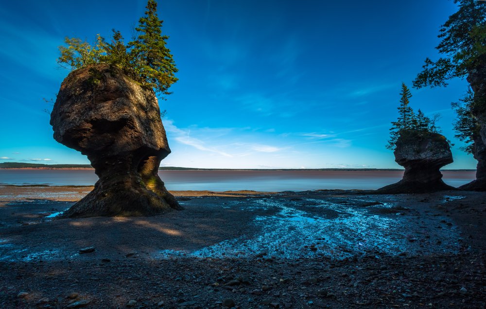 At Hopewell Rocks one can experience the world's highest tides. The tides rise up to 4 meters (13 feet) per hour and can reach a height of up to 14 meters (46 feet), New Brunswick, New England, Canada