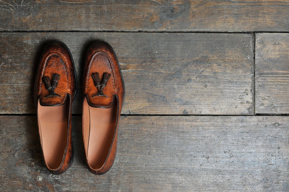 leather handmade shoes on a wooden background