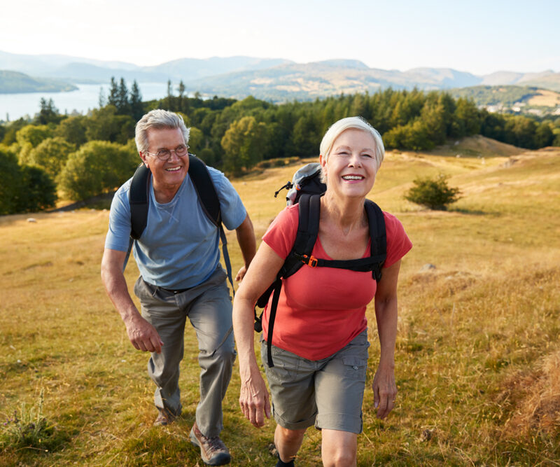 Senior couple in camping gear on hike