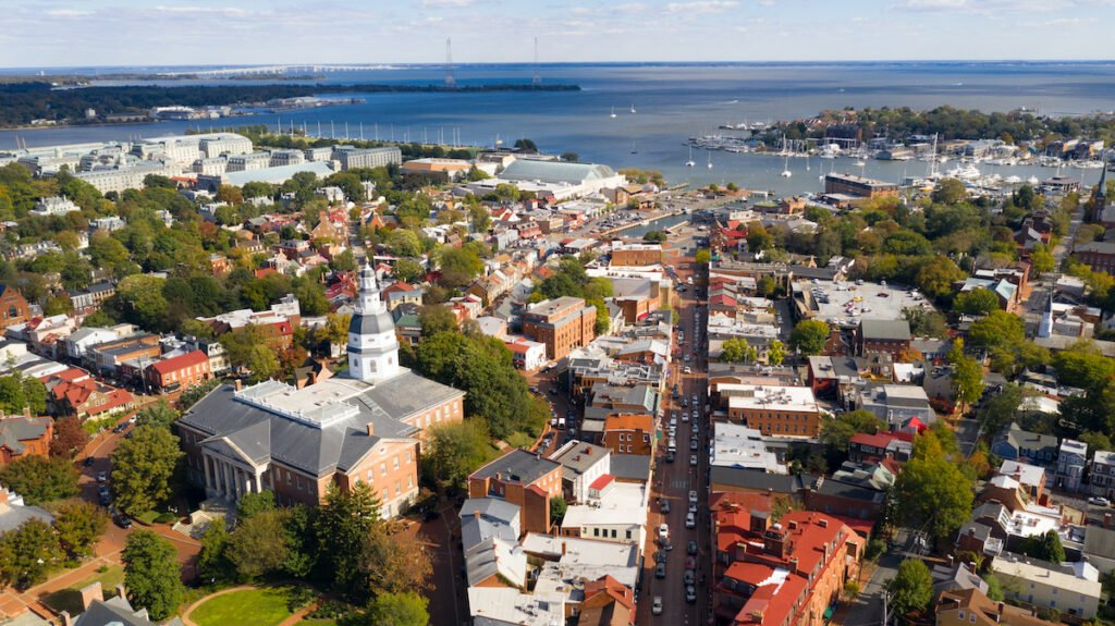 The Naval Academy Dome and Maryland Statehouse building in the aerial view of the Annapolis skyline.