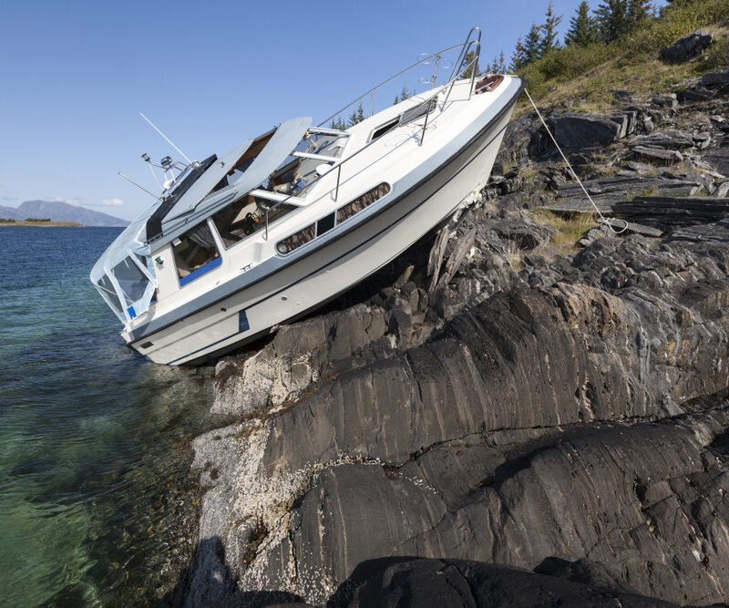 boat after collision with boulders in Norway