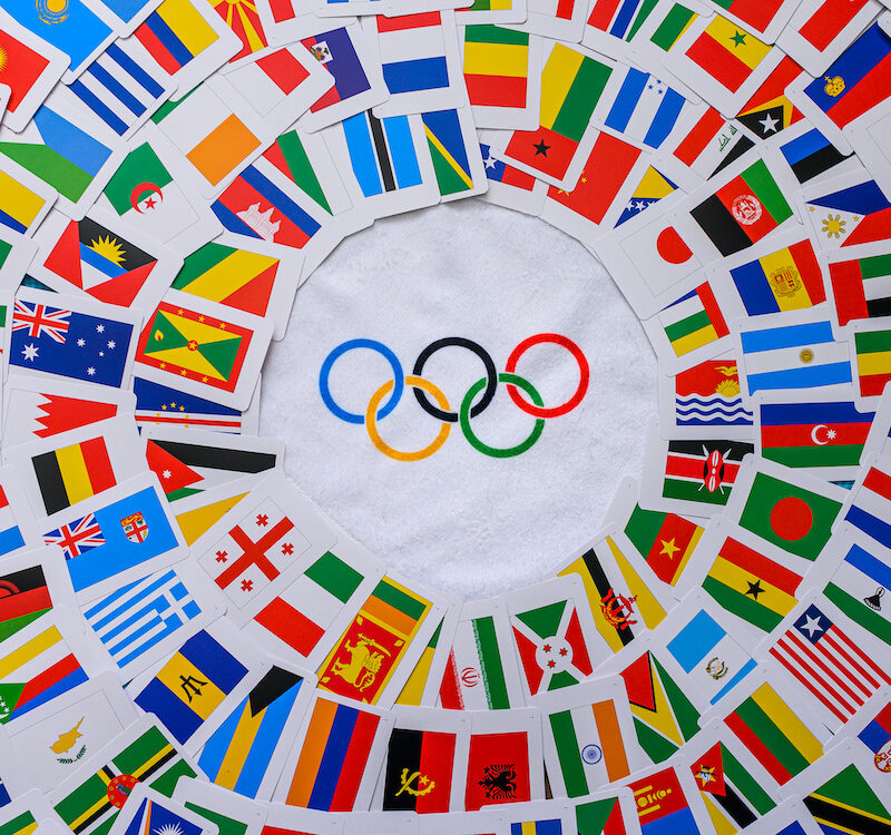 Olympic rings and colorful world flags