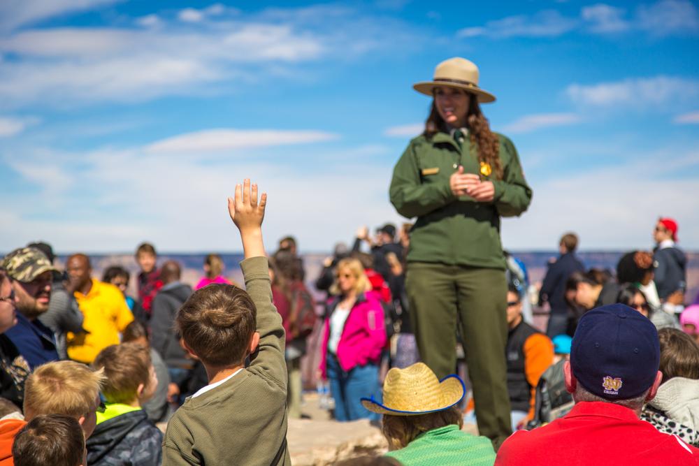 kid raising hand to ask park ranger question Grand Canyon National Park, Arizona, USA