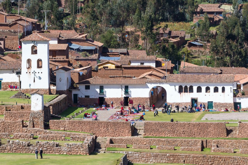 Town square and market with small Church viewed from across the valley in Chinchero, Peru.
