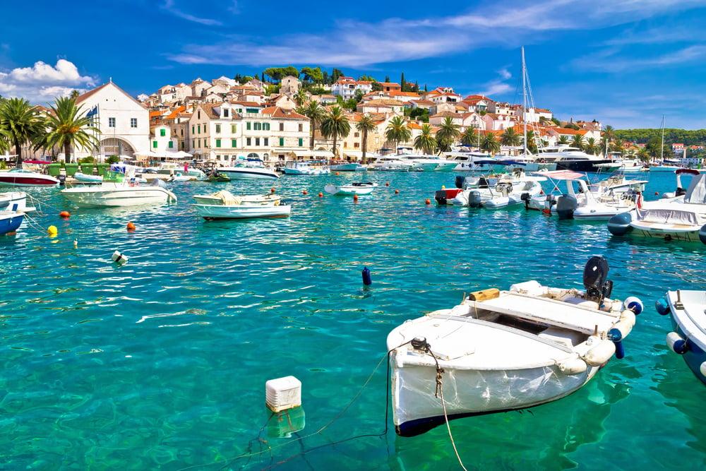 Turquoise waterfront with boatsof Hvar island in Dalmatia, Croatia