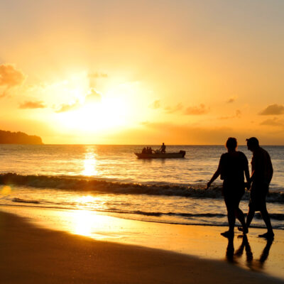 Couple walking on St. Lucia beach.