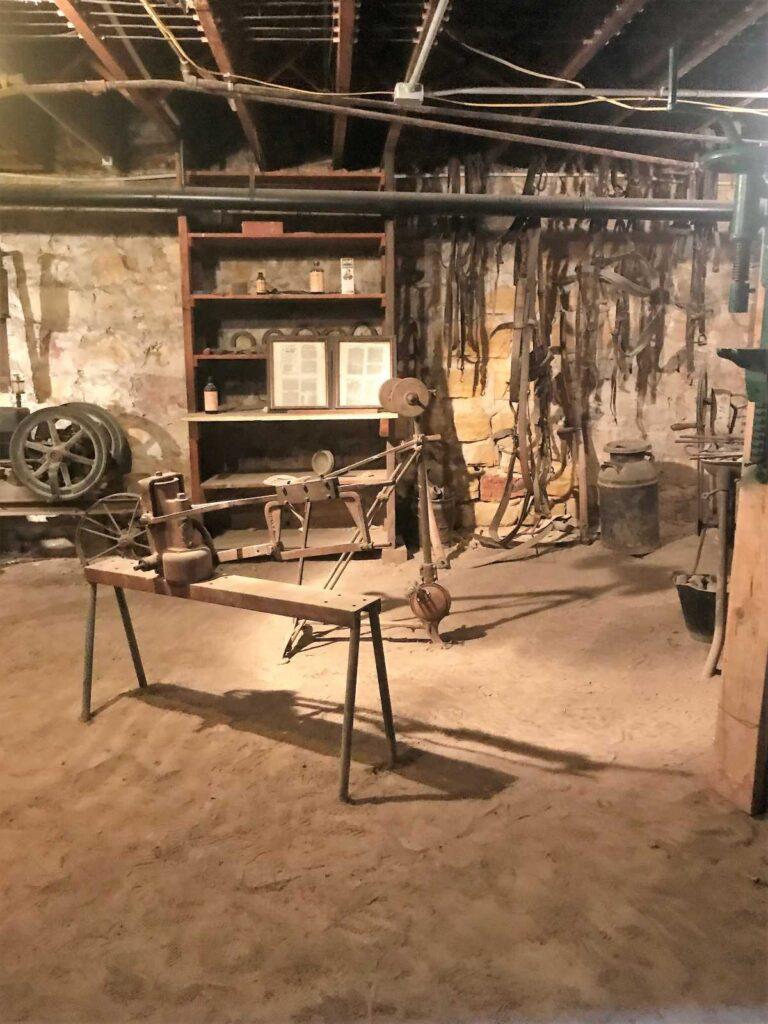 Tom Drake's Harness Shop in the beneath the Ellinwood Emporium.