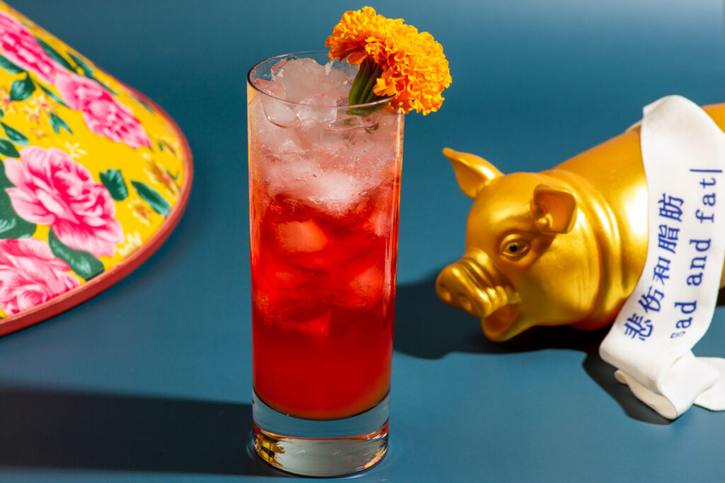 Hungman's Oasis  red cocktail with orange marigold flower