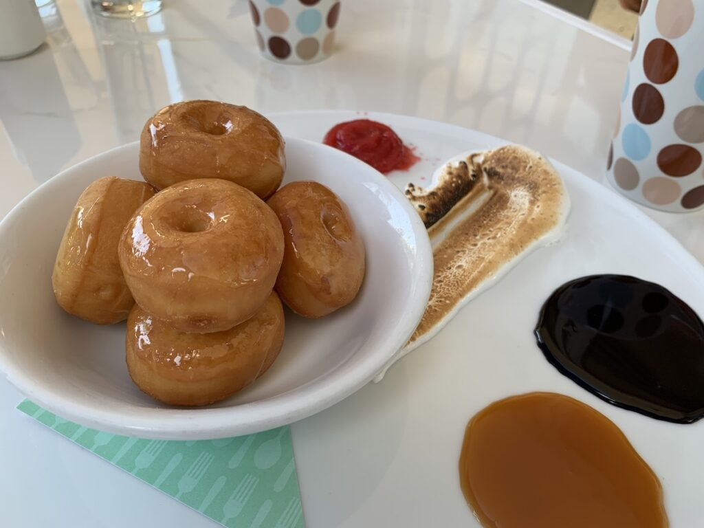 Zuzu's Breakfast featuring glazed donuts and dipping sauces.