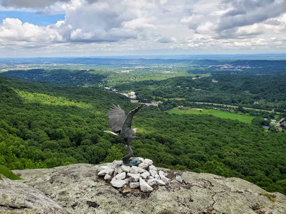 Eagle sculpture at Rock City valley in background