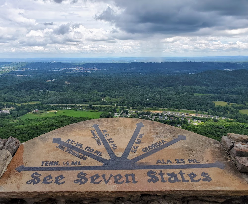 Seven States sign directions pointing to each state from 7 States Flag Court at Lookout Mountain