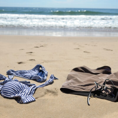 Man and woman's bathing suits on the beach