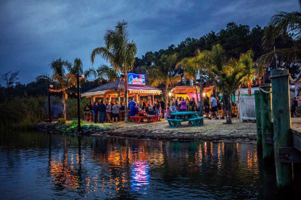 Castaways RV Resort Jackspot Tiki Bar outdoor party at night by the water