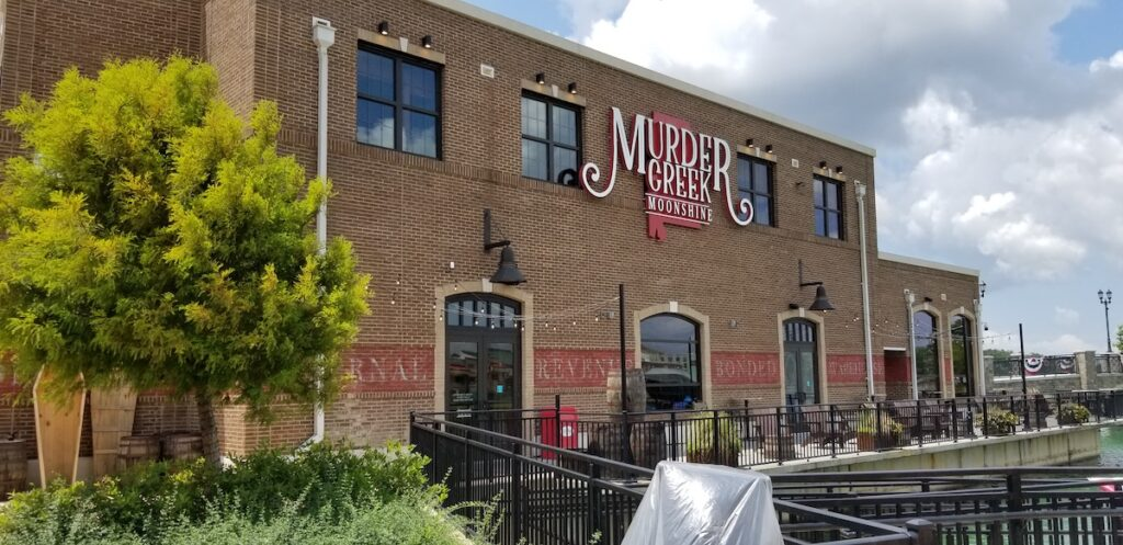 Dining experiences in Downtown OWA, Murder Creek Distillery.