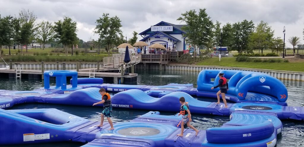 Kids and adults navigating the Gravity Island obstacle course.
