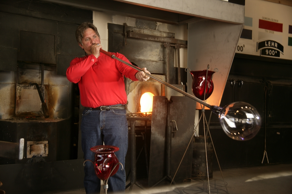 Maker at Dollywood demonstrates the art of hand-blown glass