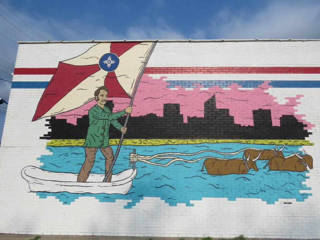 Wichita flag mural using the city flag as a boat's sail.